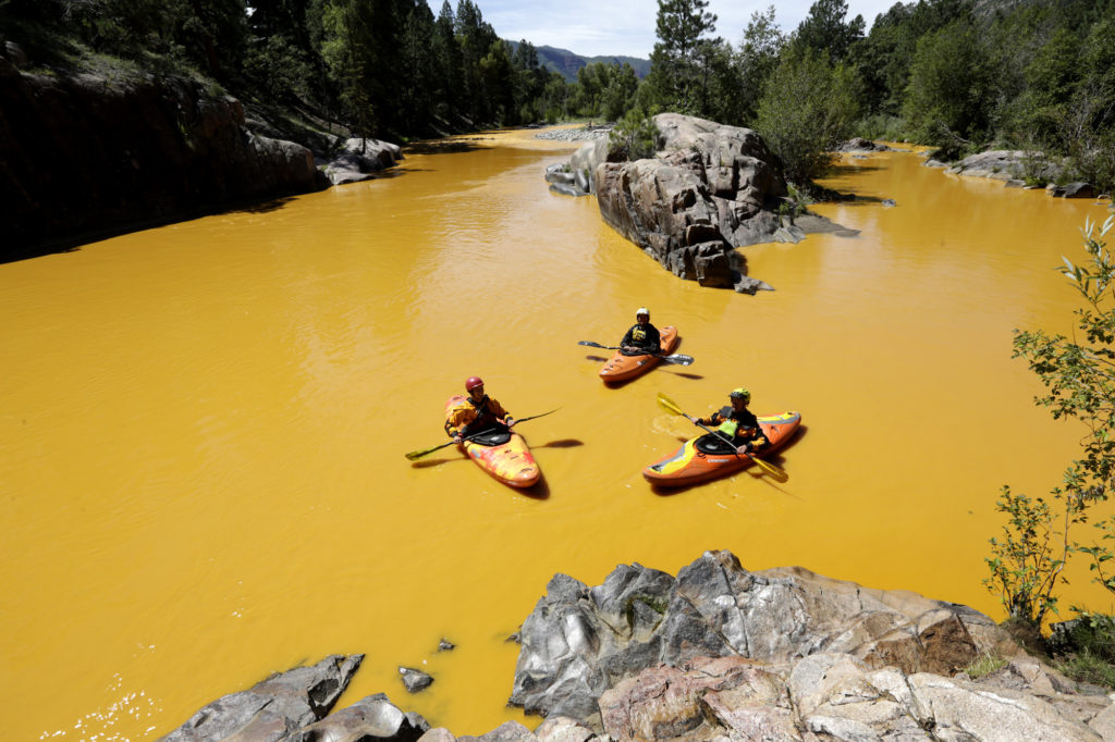 Kayakers in the Animas River near Durango, Colorado, after the spill. Credit: Jerry McBride/The Durango Herald via AP