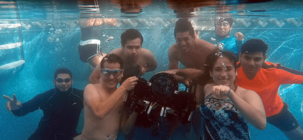 A student team (and their ROV) at an underwater robotics competition.