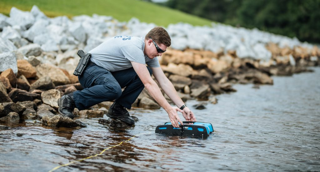 A BlueROV2 being deployed for search and rescue. (Credit: <a href='https://greenvillejournal.com/2018/08/23/local-dive-team-deploys-robot-for-underwater-recovery-missions/' target='_blank' rel='noopener noreferrer'>Greenville Journal)</a>